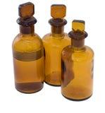 3 bruine chemische flessen Stock Foto