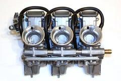 3 carburadores de una moto Fotografía de archivo libre de regalías