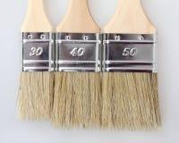 3 cepillos de pintura a estrenar Foto de archivo libre de regalías