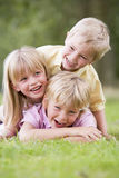 3 children playing outside