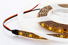3-chip LED strip wound on a disc. 3-chip LED strip with connecting wires wound on a disc Stock Images