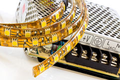 3-chip SMD LED strips with power supply. 3-chip SMD LED strips with 12V stabilized power supply Stock Image