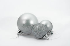 3 Christmas baulbles. 3 silver and shiny Christmas baubles Stock Images