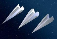 3 cohetes del origami en espacio Fotografía de archivo