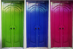 3 colorful doors. Blue pink green doors next to each other Royalty Free Stock Images