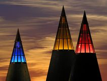 3 Colours. Three illuminated cones in front of a sunset Royalty Free Stock Image