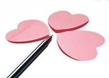 3 corazones y y una pluma Fotos de archivo