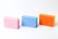 3 cores de 3 esponjas Foto de Stock Royalty Free