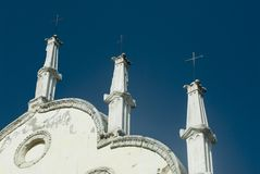 3 crosses. Three small crosses decorate the top of an old chruch...steps to heaven royalty free stock images