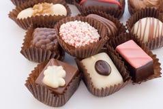 3 cukiereczki chocolat się blisko kolorowego różne Fotografia Royalty Free
