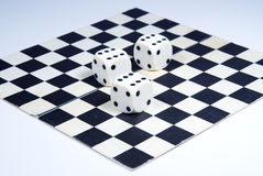 3 dice on a chess-board, isolated on a white background. 3 dice on a chess-board isolated on a white background Royalty Free Stock Image
