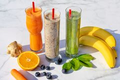 Free 3 Different Kind Of Smoothies With Ingredients On Marble Table Background Gigner Banana Blueberry Spinach Carrot Royalty Free Stock Images - 179842869
