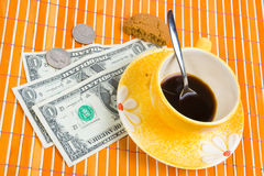 3 dollars and 50 cent pay for coffee and cookies. Three dollars and 50 cent pay for coffee and cookies on bamboo table-cloth Royalty Free Stock Photo
