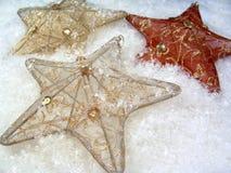 3 estrelas na neve Fotografia de Stock Royalty Free
