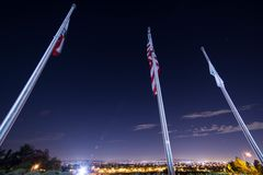 3 Flag Poles After Dark Royalty Free Stock Photo