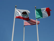 3 flags. California, U.S.A., Italy against a blue sky royalty free stock photos