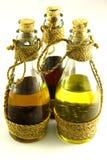 3 Flaschen mit Schmierölen stockbilder