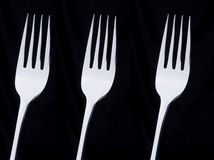 3 forks. 3 silver forks on a black background Royalty Free Stock Image