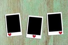 3 fotos imediatas na parede Foto de Stock