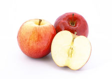 3 fresh aplles. 3 fresh apples with one sliced part isolated on white Stock Photo