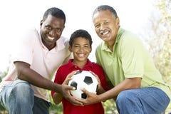 3 generaties in Park met de Bal van het Voetbal Stock Foto's