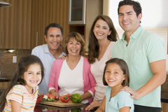 3 Generation Family Preparing Meal Together. In Kitchen Smiling stock photo