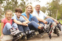 3 Generation Putting On In Line Skates Royalty Free Stock Images