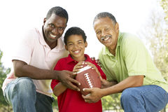 3 Generations In Park With American Football. Grandfather With Son And Grandson In Park With American Football Royalty Free Stock Images