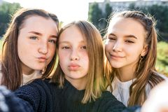 Free 3 Girls Girlfriends Teenagers, 14-15 Years Old, Taking Selfie Photo On Telephone Camera, On Autumn Day In City On Street Stock Image - 168619611