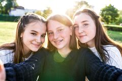 Free 3 Girls Schoolgirls, Selfie Photo On Phone Camera, Rest After School Weekend. Summer In City, Portraits Close-up Stock Image - 174084051