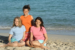 3 girls in t shirt. Three girls together by the sea wearing blank t shirts that wait for your prints( with requested copy space Stock Image