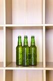 3 groene glasflessen Stock Foto's