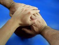 3 Hände auf einer Kugel Stockbilder