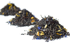 3 heaps of black Earl Grey tea isolated on white Royalty Free Stock Image