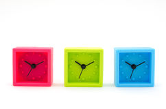 3 horloges sur le fond blanc Images stock