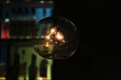 3 Incandescent Lights Bulbs in Clear Glass Dome Turned on Royalty Free Stock Photo