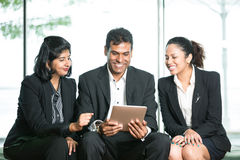 3 Indian Business people reading tablet. Stock Images