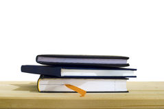 3 Isolated books. On a wooden table Stock Images