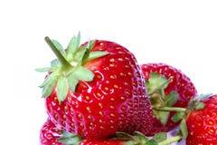 3 jordgubbar Arkivfoto