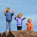 3 Kids Standing on Rock Royalty Free Stock Photography