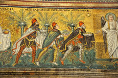 3 kings and an angel. Scene from the nativity. Three kings arrive bearing gifts. an angel is there to receive them in a 1600 year old UNESCO listed mosaic Stock Images