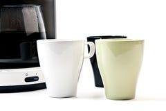 3 koppen die op koffie wachten Stock Foto