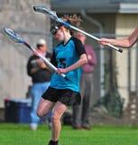 3 lacrossespelarekvinnor Royaltyfri Foto
