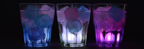 3 Lighted Clear Drinking Glass With Beverage Stock Photo