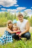 3 lyckliga folk för familj Royaltyfri Fotografi