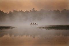 3 mensen in een boot Stock Foto's