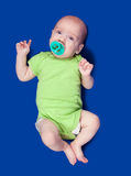 3 months baby. Isolated over blue background Royalty Free Stock Images