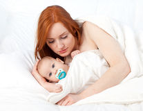 3 months baby boy with mother in bed Stock Photo
