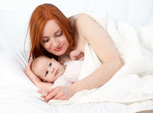 3 months baby boy with mother in bed Royalty Free Stock Images