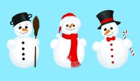 3 muñecos de nieve Imagen de archivo libre de regalías